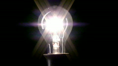 Real light bulb turning on Stock Footage