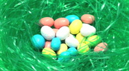 Stock Video Footage of Easter eggs candy in grass loop V2 - HD