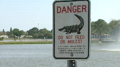 Do Not Feed Or Molest Alligators Stock Footage