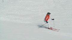 Woman skiing on a flat slope, steadycam Stock Footage