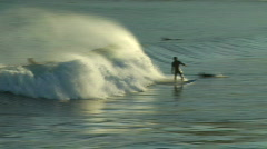 Three Surfers Attempt To Catch Wave - stock footage