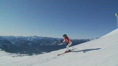 Steadycam accompanying skiing woman part I Stock Footage