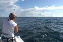 Fisherman catching a King Fish Stock Footage