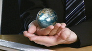 Businessman with a rotary terrestrial globe in his hand Stock Footage