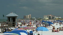 Crowded beach and lifeguard station during spring break in Florida Stock Footage