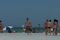 Group of spring break college age people on the beach Stock Footage