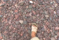 Point of View Walking on Lake Rocks Stock Footage