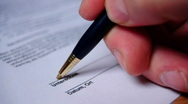 HD720p Signature on a business document in german Stock Footage