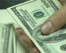 Counting dollars Stock Footage