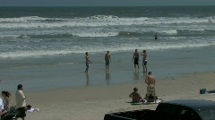 Cars and all terrain vehicles cruise the Atlantic beach  Stock Footage
