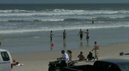Stock Video Footage of Cars and all terrain vehicles cruise the Atlantic beach