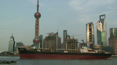 Large ship sails through downtown Shanghai part 3 Stock Footage