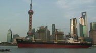 Stock Video Footage of Large ship sails through downtown Shanghai part 3