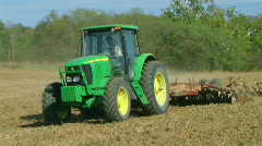 Tractor Discing Field - stock footage