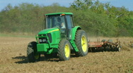 Stock Video Footage of Tractor Discing Field