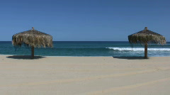 Paradise sand beach with parasol Stock Footage