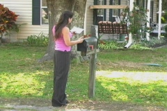 Hot Brunette Gets her Mail (sequence) Stock Footage