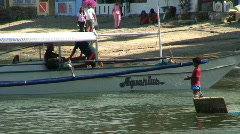 Traditional filipino banka outrigger fishing boat in Philippines Stock Footage