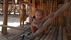 Karen Refugees: Young Children outside their shelter Stock Footage