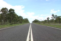 Sealed road to outback whip pan Stock Footage