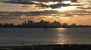 Boston skyline at sunset from harbor Stock Footage