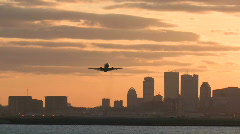 Boston skyline harbor sunset takeoff follow Stock Footage