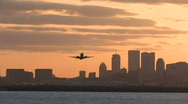 Stock Video Footage of Boston skyline harbor sunset takeoff follow