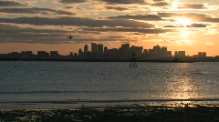 Boston skyline harbor sunset takeoff wide - stock footage