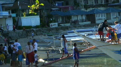 People walking of a banka outrigger boat in Sabang in Philippines Stock Footage