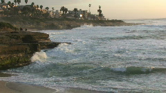 San Diego Ocean Coastline with Rock Cliffs at Dusk - stock footage