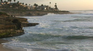 Stock Video Footage of San Diego Ocean Coastline with Rock Cliffs at Dusk