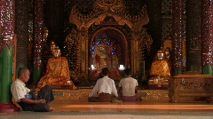 Myanmar: People meditate at a Buddhist temple Stock Footage