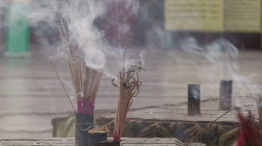 Myanmar: Incense burning at a Buddhist temple Stock Footage
