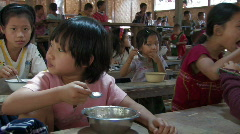 Karen Refugees: Students eat a hot lunch at school Stock Footage