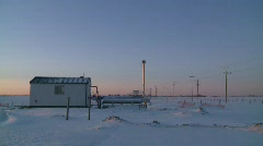 Oil & gas, remote gas compressor station at sunrise Stock Footage