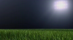 Soccer ball fly and landing on grass. - stock footage