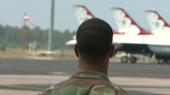 Military Personnel Walks On An Airbase - stock footage