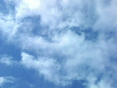 Stock Video Footage of Clouds zooming on blue sky