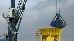 Crane unloading cargo ship in harbor Stock Footage