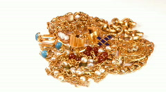 Stock Video Footage of Pieces jewelry in gold rotate