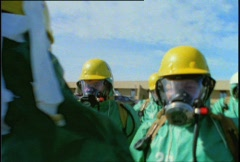 Men in Decontamination Suits Stock Footage