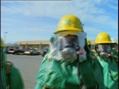 Stock Video Footage of Men in Decontamination Suits