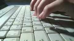 Typing fingers move over a white notebook keyboard Stock Footage