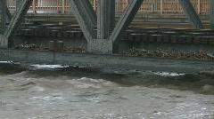 Railway bridge flood zoom back Stock Footage