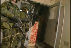 Military, soldiers fires weapon, urban combat Stock Footage
