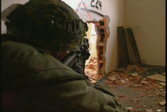 military, soldiers, firefight, aiming rifle through opening in building - stock footage