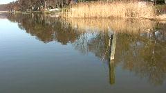 Mooring post in Lake Sjaelsoe, Denmark Stock Footage