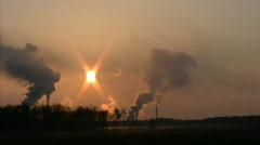 Time-lapse of sunset through smoke from chemical plant 3 Stock Footage