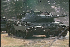 military, smoke and leopard tanks, troops using cover - stock footage
