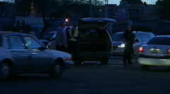 Traffic tracking through accident scene Stock Footage